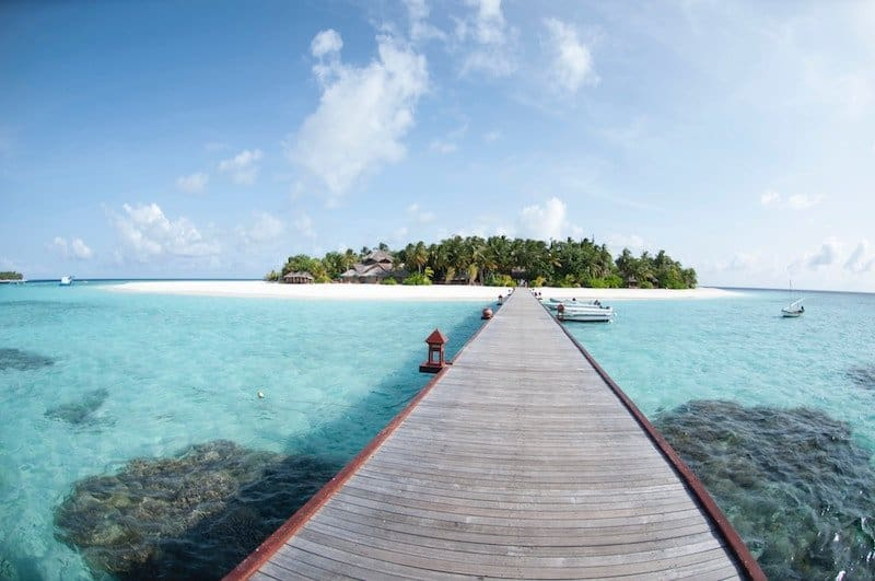 Wooden bridge over water in Maldives