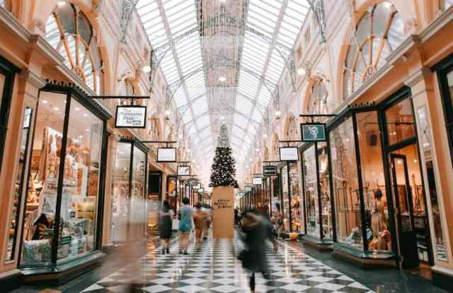 Block Arcade Melbourne. A light filled shopping arcade with high ceilings and checkered tile floors.