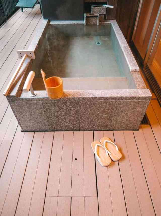 Traditional Japanese outdoor soaking tub at Hotel Hakone Gora Byakudan