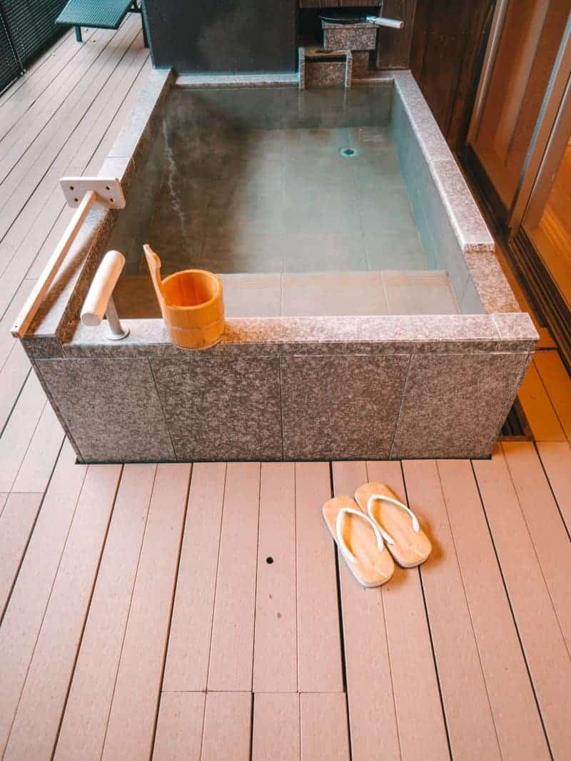 Traditional Japanese outdoor soaking tub at Hotel Hakone Gora Byakudan
