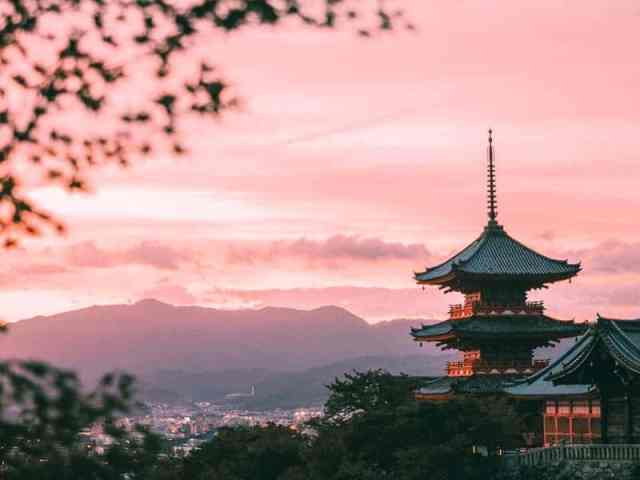 Kiyomizu-dera temple at sunset overlooking Kyoto city.