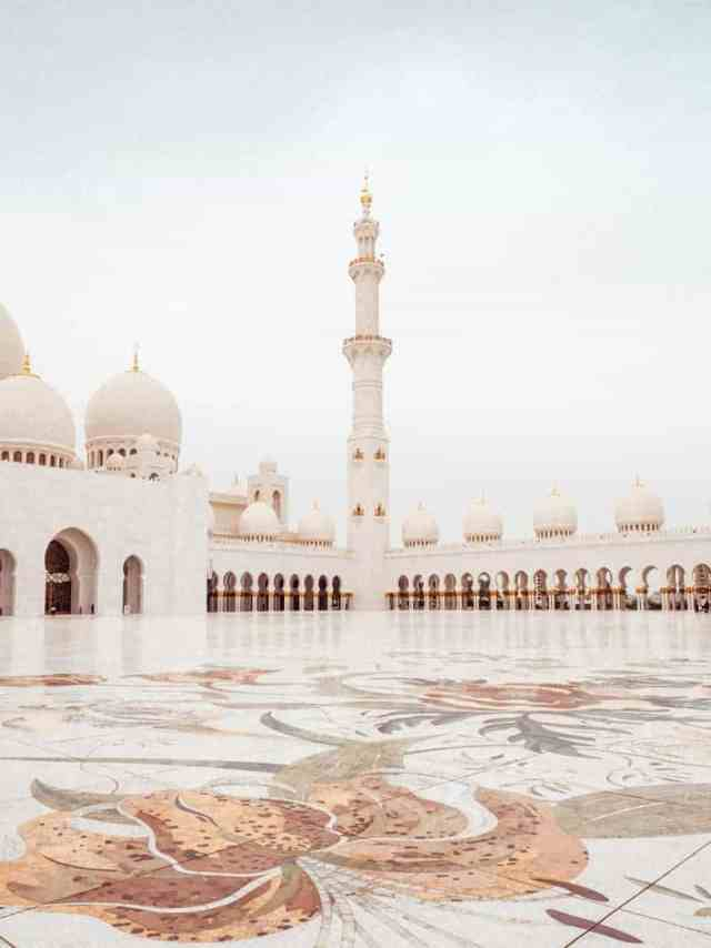 Abu Dhabi Grand Mosque tiled courtyard with minarets in the background