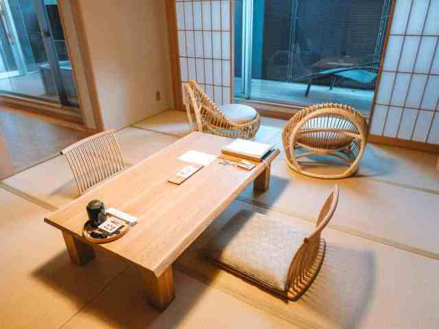 Traditional Japanese tatami flooring, table and interior decoration at hotel Hakone Gora Byakudan