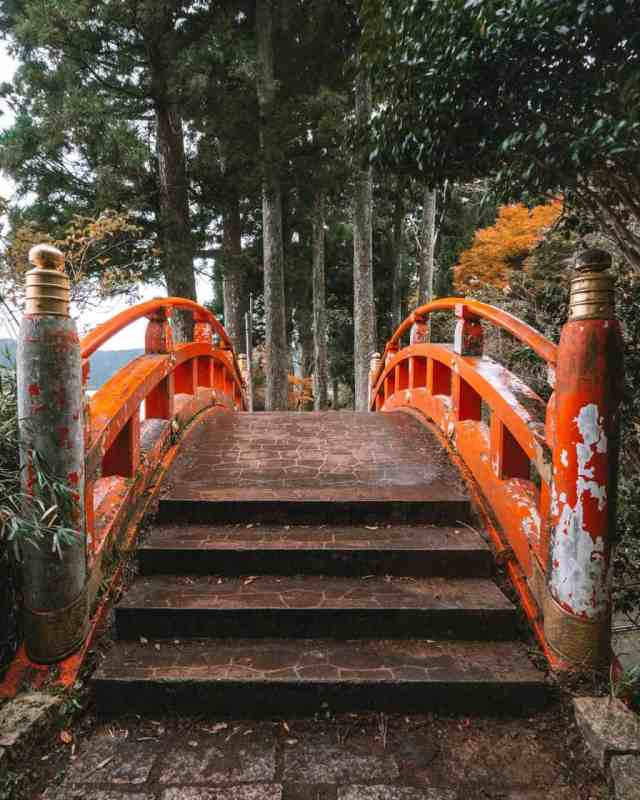 An orange Japanese footbridge pathway leading to the Hakone Shrine, Japan