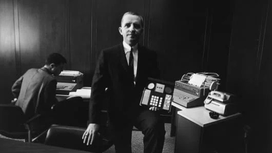 1968: American businessman H. Ross Perot holding a business machine manufactured by his company, Electronic Data Systems, Dallas, Texas.