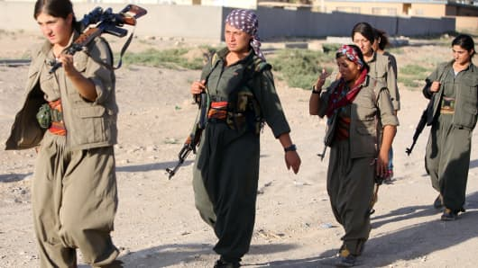 A picture taken on August 21, 2014 shows women Kurdistan Workers Party (PKK) patrolling on the front line in the Makhmur area, near Mosul, during the ongoing conflict against Islamic State (IS) jihadists.