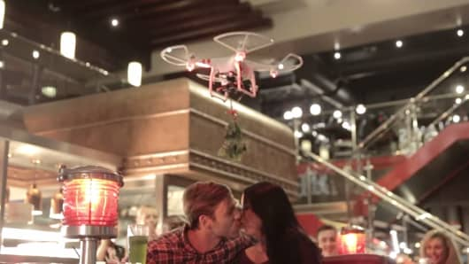 "The drones were intended to hover over couples and inspire a little ""mobile mistletoe mischief,"" according to TGI Fridays."