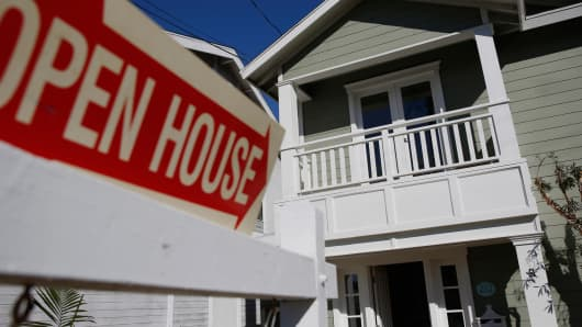 Open House signage is displayed outside of a home for sale in Redondo Beach, California.
