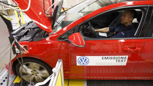 A worker tests a red 2016 Volkswagen AG Golf TDI emissions certification vehicle inside the California Air Resources Board Haagen-Smit Laboratory in El Monte, California.