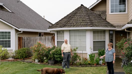 Chuck Hubbard and his wife Pamela, who managed to get a quick foreclosure rescinded only after going to court, outside their home in Sacramento, Calif., June 10, 2015.