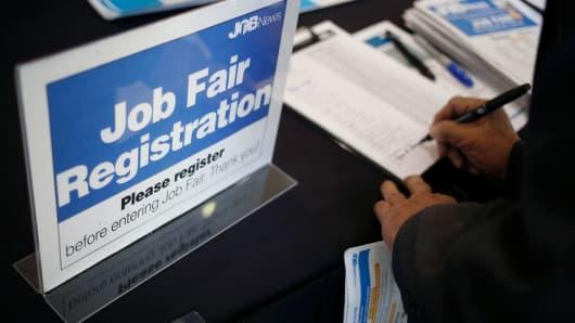 A job seeker registers during a Job News USA career fair in Overland Park, Kansas.