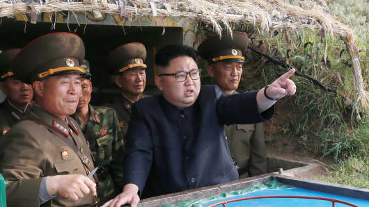 This undated picture released from North Korea's official Korean Central News Agency (KCNA) on May 5, 2017 shows North Korean leader Kim Jong-Un inspecting the defence detachment on Jangjae Islet and the Hero Defence Detachment on Mu Islet.