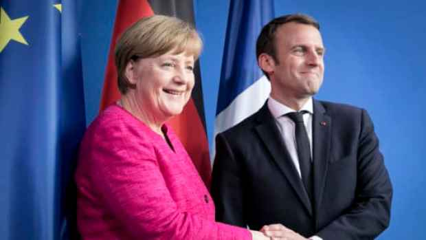 German Chancellor Angela Merkel and newly-elected French President Emmanuel Macron attend a press conference at the Chancellery on May 15, 2017 in Berlin, Germany.