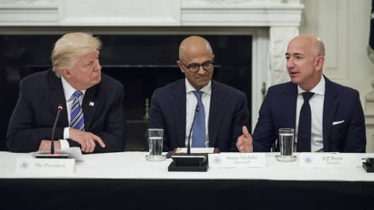 Jeff Bezos, president and chief executive officer of Amazon.com Inc., right, speaks as U.S. President Donald Trump, left, and Satya Nadella, chief executive officer of Microsoft Corp., listen during the American Technology Council roundtable hosted at the White House in Washington, D.C., U.S., on Monday, June 19, 2017.