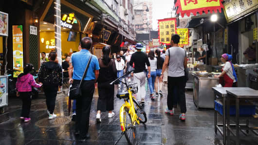 A bicycle from bike-sharing startup ofo in the Muslim Quarter of Xi'an, China.