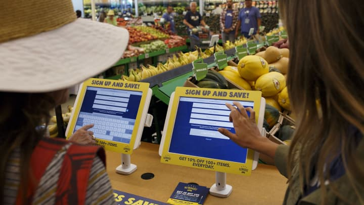 Customers register for the 365 Rewards discount program during the grand opening of a Whole Foods Market 365 location in Santa Monica, California.