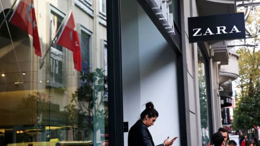 A shopper exits a fashion retailer Zara branch in an Istanbul upscale neighbourhood, Friday, Nov. 3, 2017. Shoppers at Zara in Istanbul have found unusual tags on their garments: put there by Turkish workers complaining they have not been paid for the manufacturing the merchandise in the store.
