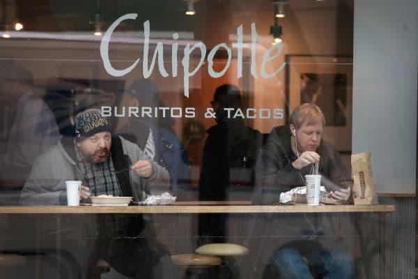 Diners eat at a Chipotle restaurant in Chicago, Illinois.