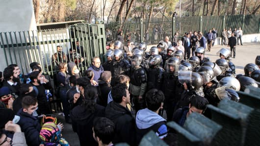 Iranian students scuffle with police at the University of Tehran during a demonstration driven by anger over economic problems, in the capital Tehran on December 30, 2017.