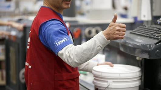 An employee prepares a paint order for a customer inside a Lowe's Cos. store in Burbank, California.