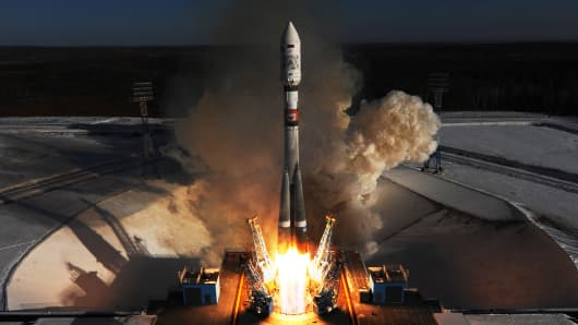 A Soyuz 2.1a rocket booster launches from Russia's Vostochny Cosmodrome. The Soyuz 2.1.a was set to deliver Russian Kanopus-V No3 and No4 remote sensing satellites and 9 small satellites to orbit.