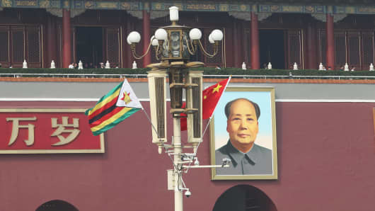 Chinese and Zimbabwean national flags in front of the Tian'anmen Rostrum on April 3, 2018, in Beijing, China.
