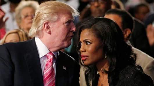 Republican presidential nominee Donald Trump and Omarosa Manigault (R) attend a church service, in Detroit, Michigan, U.S., September 3 2016.
