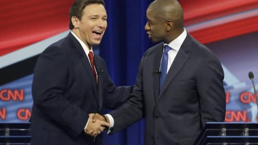 Florida Republican candidate governor Ron DeSantis, on the left, shakes hands with candidate Democratic governor Andrew Gillum after a CNN debate on Sunday, October 21, 2018, in Tampa, Florida.