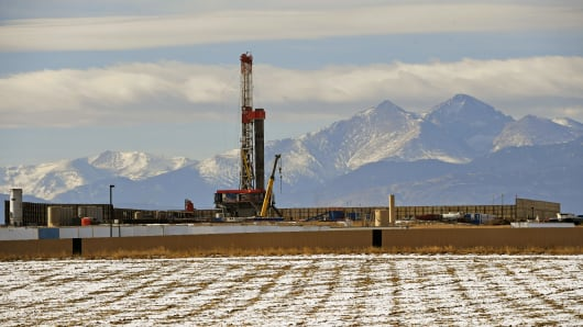 A big fracking operation is becoming a new part of the horizon. Mount Meeker and Longs Peak tower in the background on December 28, 2017 in Loveland, Colorado.