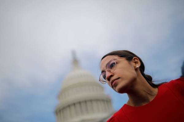 The elected deputy Alexandria Ocasio-Cortez of New York arrives for a class photo with the newly elected members of the US House of Representatives on Capitol Hill in Washington, United States, November 14, 2018.