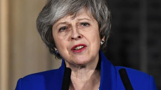 Britain's Prime Minister Theresa May makes a statement following winning a confidence vote, after Parliament rejected her Brexit deal, outside 10 Downing Street in London, Britain, January 16, 2019.