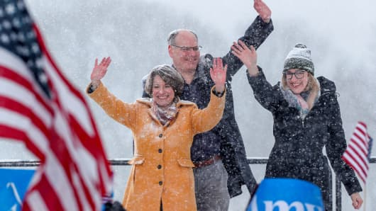 Senator Amy Klobuchar waves to the crowd with her husband John Bessler and daughter Abigail Bessler after announcing her candidacy for the 2020 Democratic presidential nomination in Minneapolis, Minnesota, February 10, 2019.