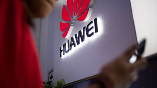 A Huawei logo displayed at a retail store in Beijing.