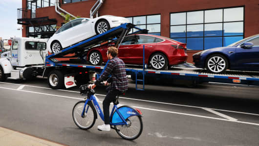 Tesla cars are delivered to a showroom in Brooklyn, New York on April 25, 2019.
