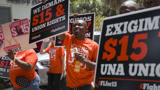 People gather together to ask the McDonald's corporation to raise workers wages to a $15 minimum wage as well as demanding the right to a union on May 23, 2019 in Fort Lauderdale, Florida.
