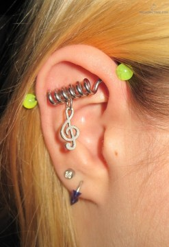 industrial piercing spiral music note