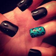 black acrylics teal accent nail