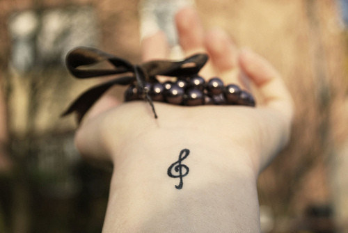 Small treble clef tattoo