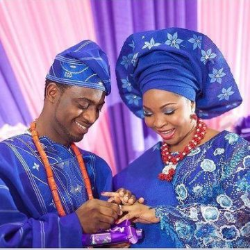 couple on dark blue aso oke dress