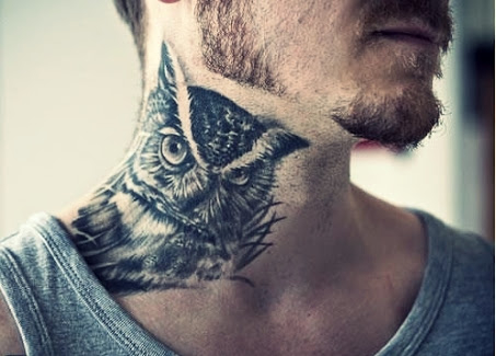 awesome owl tattoo on neck