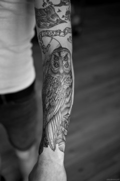 creative idea of an owl tattoo