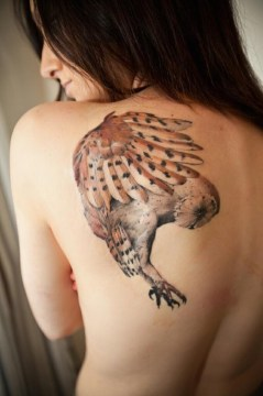 fearless owl flying tattoo
