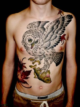 plucky owl catching fish tattoo