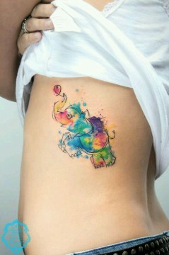 watercolor elephant tattoo on rib cage