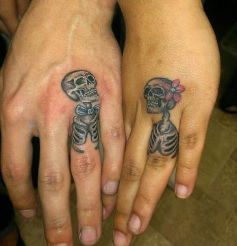 small skeleton couple tattoo