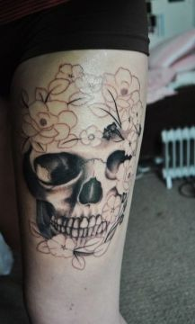 leg skull face tattoo