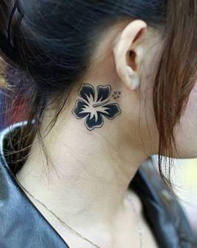 hawaiian flower tattoo on neck side