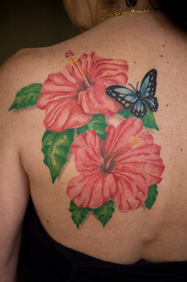 hawaiian flower with butterfly tattoo on upper back