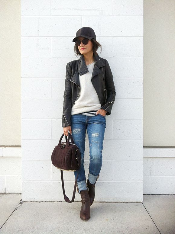 leather jacket baseball cap woman