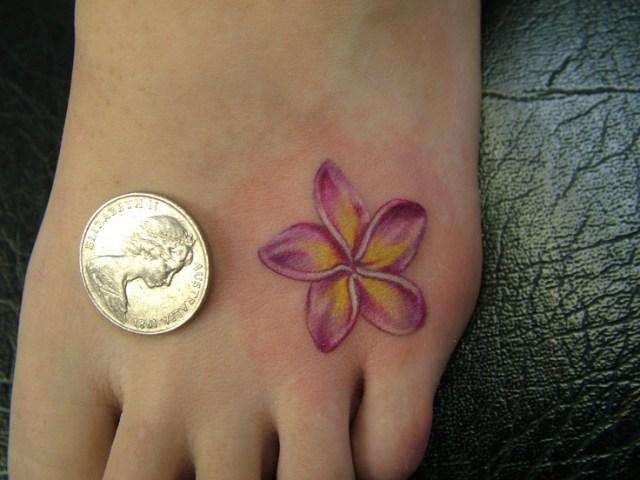 plumeria tattoo on foot